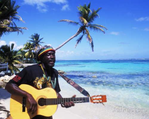 Bill bachmann reggae singer with guitar on beach sainte anne guadeloupe